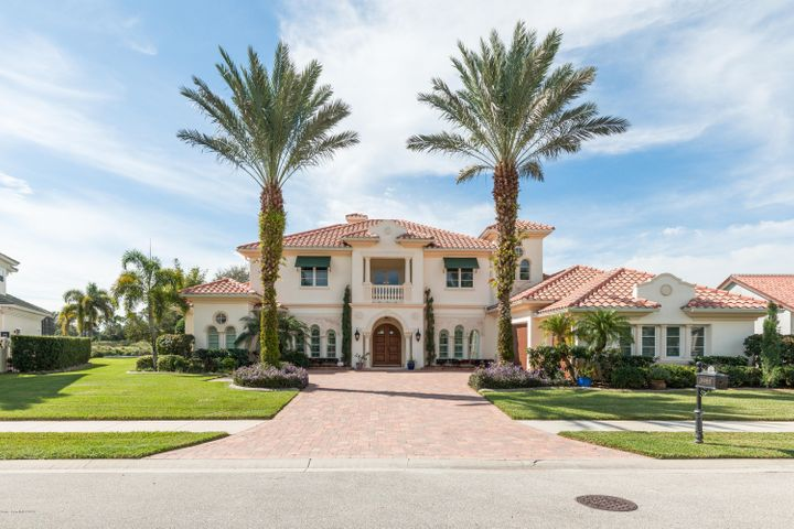 Exquisite, custom-built Viera West pool estate located in exclusive, guard-gated neighborhood Wyndham at award-winning Duran Golf Club! The soaring, mature palms, brick paver driveway, & ornate exterior details bring a dramatic & luxurious entrance. Enter into the grand foyer with a breathtaking, million dollar view of the pool, lake, & golf course. Style & symmetry is abound with stunning tray ceilings & crown molding in all the living spaces & bedrooms. The spacious Chef's kitchen features granite countertops, custom solid-wood cabinets, & a Wolf gas range. The downstairs master suite exits to the pool & offers a luxury bathroom with marble floors, double sinks & vanities, jetted tub, & walk-in shower with dual shower heads. Incredibly functional floor plan with 3 FULL ensuites PLUS a loft upstairs all exiting to their own private balconies. This home is perfect for entertaining with it's fully equipped bar, speakers inside & outside, & a resort style pool. The neighborhood encapsulates the perfect Florida lifestyle with its tropical landscaping, high-end golf course, & proximity to the best dining & entertainment on the Space Coast. Please see documents for a full list of features & schedule your private showing today!