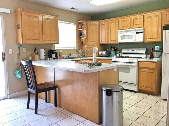 Raised Panel Cabinets, Tile Floors & Gas Stove