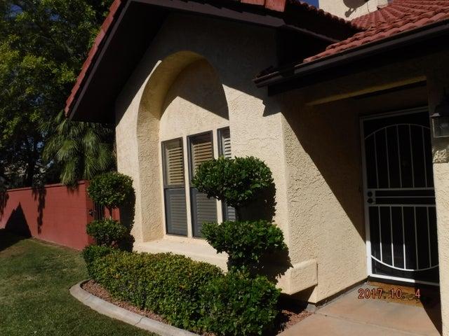 Front door has metal security door allowing cool breeze through a securely locked door.