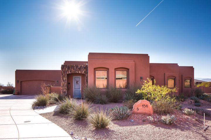 Captivating Iconic pueblo revival style north facing home with views of Snow Canyon