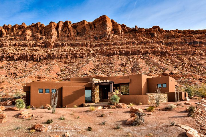 Dramatic location and views of Kachina Cliffs. This luxury home affords panoramic views of valley, Entrada, city, and desert mountains. You have a secluded backyard and stunning views of Kachina Cliffs.