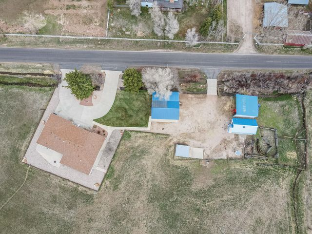 Here is your upgraded custom home, casita, barn, office, tack room and pasture all 29 acres.