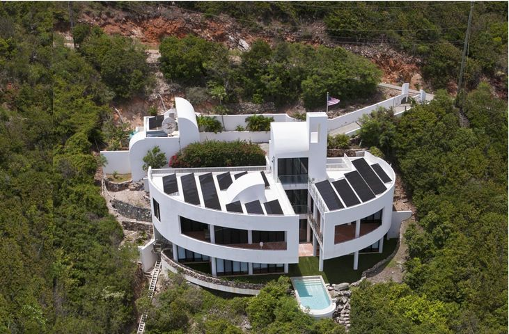Dramatic Contemporary Architecture with solar panels on roof.