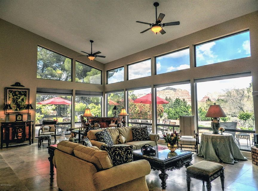 Now available to VACATION RENT. Fabulous large Southwest Contemporary home completely remodeled, with a huge 1600 sq.ft. guest home. 4 car garage and all new HVAC with a whole house generator.  Drastically reduced from $1,195,000 to $869,000 and price to sell.  Awesome Views all the way to Bell Rock and Beyond.  Do not miss seeing this beauty and living in the town touted ''Most Beautiful Place on Earth''!!only exclusion is the Red Chandelier. Natural gas is right at the corner of the lot and easy to bring up to the house. The stove top is already stubbed for gas.