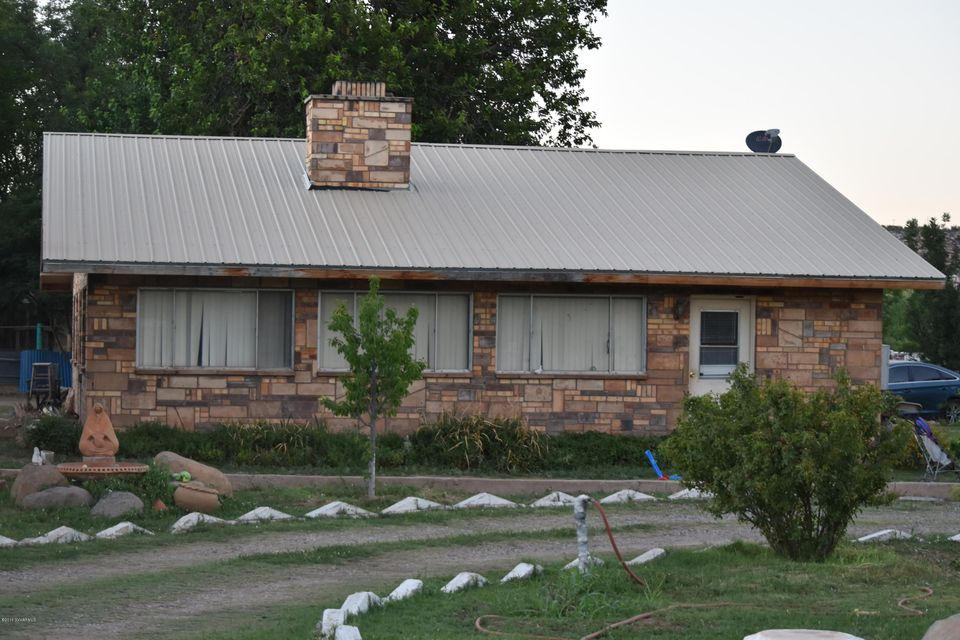 This 4bd, 2 ba home is on 3.63 with horse corral, large barn & several out buildings. One of the out buildings will not be included in sale. This property can be bought separate or in conjunction with other properties that will give an investor the potential of a possible vineyard, small subdivision and agricultural rights. See mls #510657. Square Footage of home to be verified. This property has irrigated rights and is located near Verde River with an abundance of water which is a rare commodity in Arizona. Square footage of home to be verified.