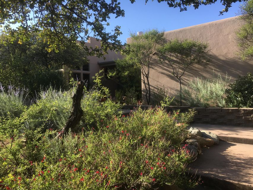 Welcome home! Beautiful Santa Fe style home designed by the Design Group.  Warm and inviting with Saltillo tile floors throughout.  Formal dining room will accommodate all the family.  Built in breakfast nook table.  Gourmet kitchen with antique butcher block island.Large master suite with gas log fireplace and walk in shower/tub that fully take advantage of the Mingus Mt views.Pool and spa with private deck off master.  RV pad and all mature and natural landscaping with drip for easy maintenance. Passive solar design keeps utility bills low. Split zone hvac.Home has been meticulously cared for inside and out and shows pride of ownership. 360 degree views. Tucked in 5 acres of native beauty makes you feel like you are in your own private world yet just minutes from town