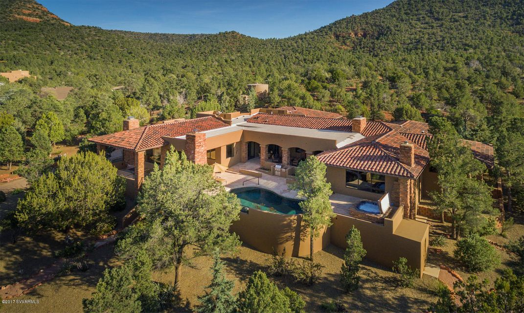 This is a true luxury property that's ideal for the passionate equestrian or car collector, set against the US National Forest with inspiring, breathtaking panoramic red rock views on 5 stunning acres, creating an unparalleled luxury estate that has it all: The 6,151 sf. single-level Main Residence, a beautiful and spacious Guest Casita, a separate Guest House/Bunk House, a 1,712 sf. Separate Car & RV Garage that's truly the ''Garage-Mahal'', ideal State-of-the-Art Horse Facilities, a serene Pool and Spa patio that looks out to the incredible views and absolutely stunning grounds. Every part of this property is immaculately and lovingly maintained. Known as ''Spirit Lifter'', this luxury residence captures the very essence of Sedona from top to bottom, end to (See Supplemental Remarks)