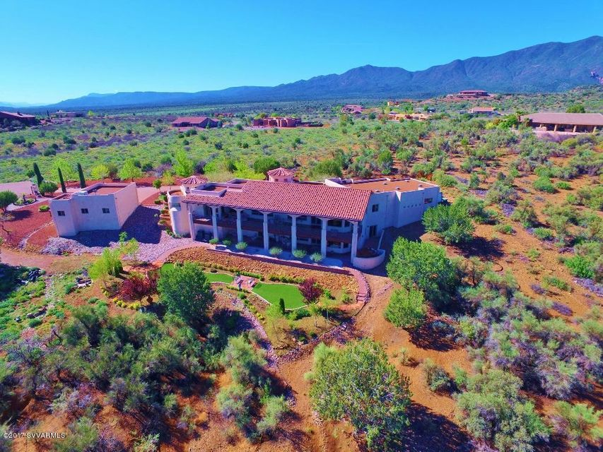 Mediterranean inspired estate spans 2.91 acres in the Mingus mountain foothills offering precious privacy.The craftsmanship and premium hilltop location are designed to take in the panoramic views of the Verde Valley, Mingus mts & red rocks. Hiking in nearby national forest. Gardens are modeled from owners time in Lucca, Italy: fountains, tree canopies & flower gardens.10,000 gallon water tank & irrigation lines are set up for vineyards.3 car garage with workshop and an additional 2 car garage. Master BR/LR/formal DR/office/laundry/kitchen on main level. 739 sq.ft. casita. Outdoor living on spacious decks with ample room for entertaining. Art niches & eyeball lights throughout. Lower level: family room, 3 bedrooms, 2 bath, kitchenette, wine cellar.No HOA: Potential AIRBNB or VRBO use.