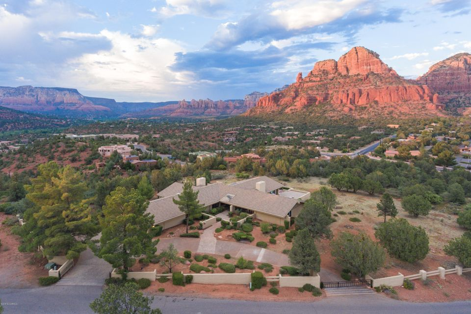 This price for 6.348 acres (now including Lot 29 at Mystic Hills); a sub-divisible, developer's dream. Regardless, iconic, Don Woods classic (Sedona) design showcases superb views on 5+ acres in coveted Sky Mountain. 5,346 sq ft single-level living split floor plan has towering cathedral ceilings drawing light in living room & formal dining room. 4 Bdrms and 4.5 bths. Tongue & groove ceilings, built-in library & wet bar highlight family room. Gourmet skills  with stainless double ovens, electric cooktop & warming drawer & tons of storage/pantry space. Unique split master retreat has separate ensuites and cedar lined walk-in closets. Also has 3 bdrms, executive office, 4bths, and 3 fireplaces. Entertain on multiple patios or lounge in the pool. Check out MLS 514693 for 3.067 acre + home.