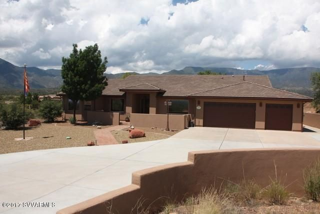 Remarkable views from every angle of this home!!  It's 3396 SqFt on 2 AC, built in 2004 in the foothills of Mingus Mt. just minutes from all amenities and from Sedona.  5BR, 4.25 BA PLUS an office and a game room allows for the entire family or for entertaining guests, and what a beautiful serene location to work from home.  Wood laminate floors with some carpet & tile.  Large kitchen with granite countertops & copper accents.  3 Bedroom suites with an attached bath plus a jack & jill bathroom for the remaining 2 bedrooms & a guest 1/2 Bath.  Split floor plan.  Master suite has a large walk in closet, jacuzzi tub, his & hers sinks, walk in shower and french doors opening to the back patio with gorgeous views of Mingus Mt.  2nd Bedroom has a jacuzzi tub and it's own private courtyard...