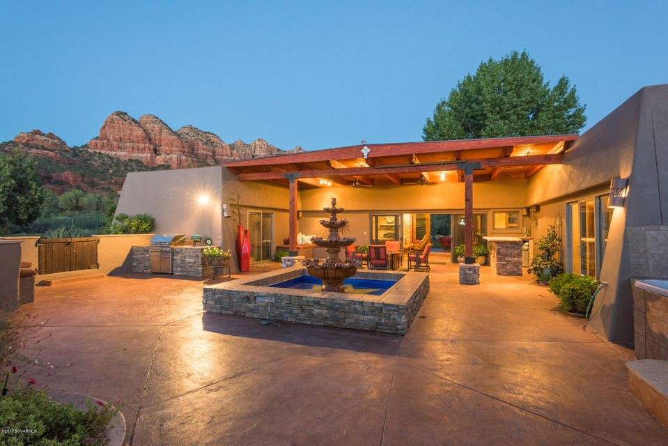When USA Weekend compiled their ''Most Beautiful Places in America'' list, Sedona claimed the top spot! Start with scenery that makes your heart leap, this rare home and property is ideally suited for the connoisseurs of nature desiring serenity, privacy, and an escape from a busy and fast-paced lifestyle.Property is situated on 1-Acre and sits on over 440 ft. of forest service boundary which gives this property an extremely private feeling with the secure knowledge that you will never have any developments to obstruct your incredible views. Residence is 3,100 SqFt., all single-level; includes three (3) bedrooms in the main residence and complete mother in-law suite with kitchenette; bedroom & full bath. Because there are NO HOA restrictions, short-term vacation rental is OK!