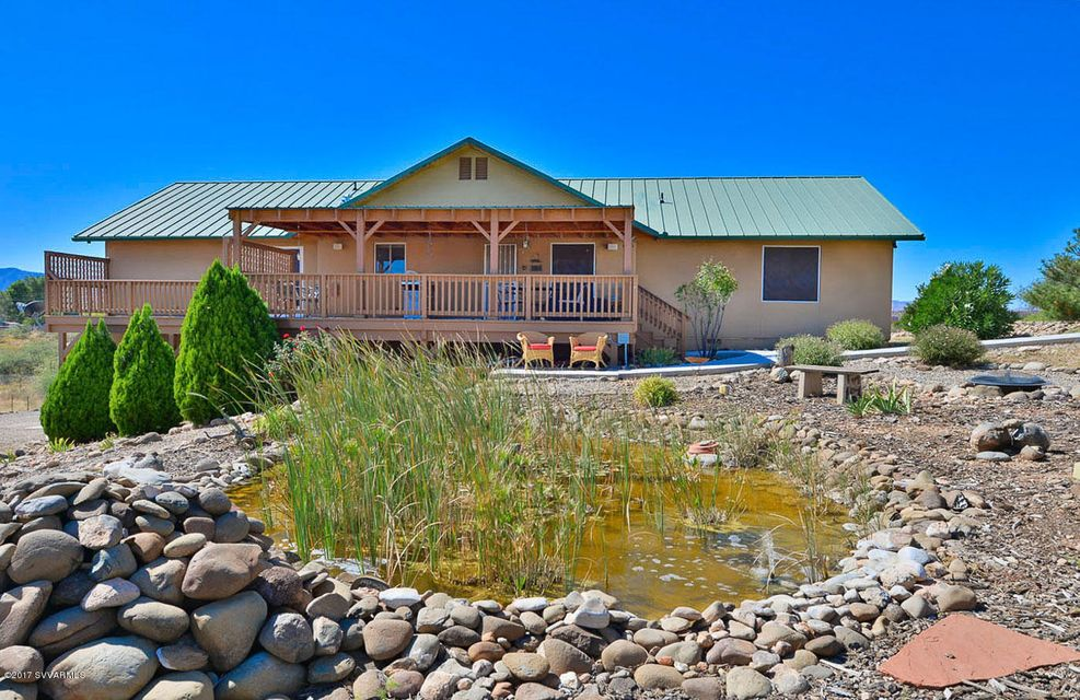 This beautiful home is situated with 360 degree sweeping views of the verde valley which can be appreciated from the exterior covered & uncovered decks, inside, & all throughout the property.  Situated on over 2.5 acres this home has it all.  RV parking, 2 separate detached 2-car garages.  Solar sytem.  Kitchen features a state of the art induction stove with beautiful stainless steel range hood, Island with river rock.  Beautiful Knotty Alder cabinets and wood laminate floors throughout.  Granite kitchen and bathrooms.  Master bedroom features 2 walk in closets, separate make up vanity, huge shower with double rain shower heads, bathroom with bidet and french doors to the deck.  See attached supplement for additional description..