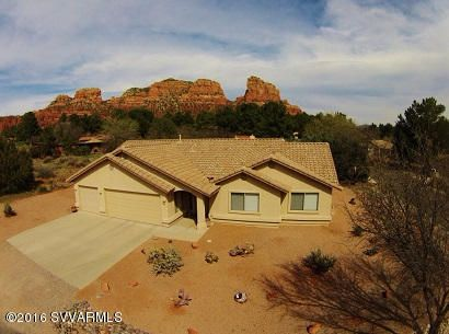 Corner lot with red rock views from Great Room, Master, covered back patio.