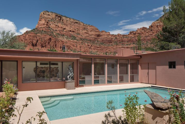 Architect designed custom southwest contemporary built around a central courtyard with swimming pool. Located in prestigious and desirable Chapel area very close to U.S. Forest trails.