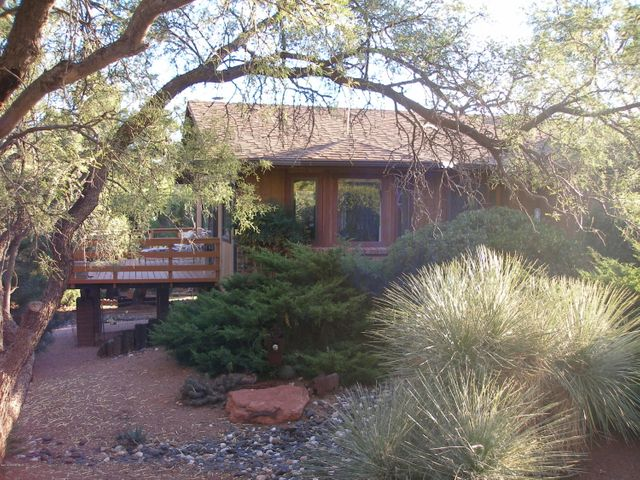 Lovely private setting with mature vegetation yet looming red rock views to the front. Fabulous wrap around Deck to enjoy Castle Rock!