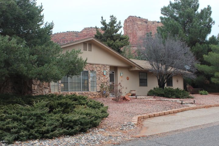 Front view of home with red rocks in background