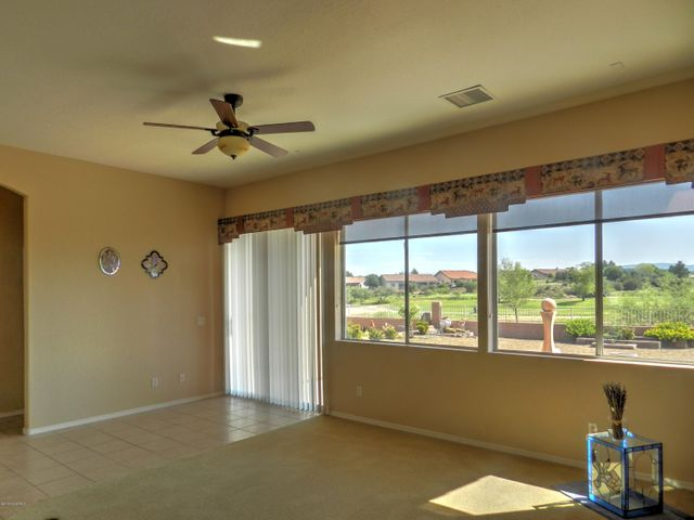 Expansive views of the Golf Course and distant Red Rocks. Wide, open spacious feeling.