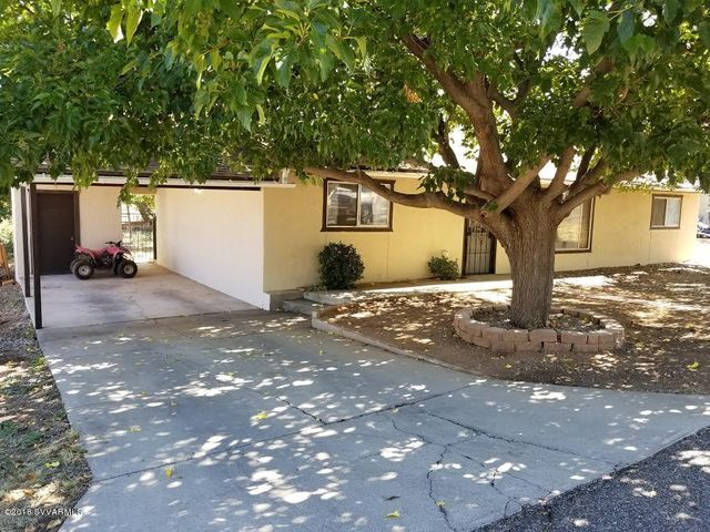 Front of home with 3 large Mulberry Trees for shade.