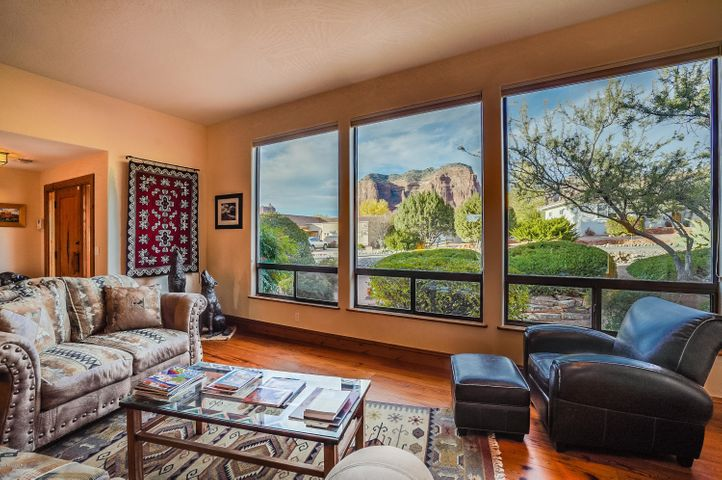 Great room living off the kitchen with picture views of Courthouse Butte and Lee Mountain.