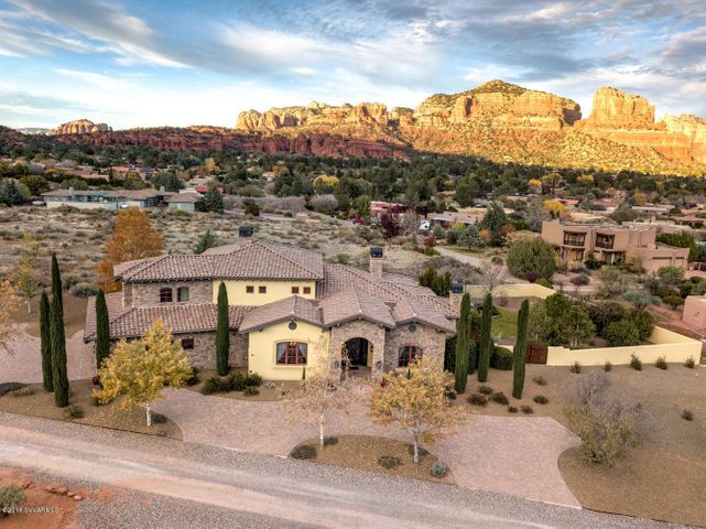 Aerial view of home with red rock views