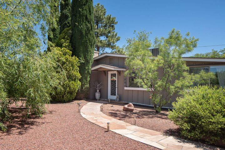 Flagstone walk, low voltage lighting to contemporary front door; Mimosa and weeping willow trees