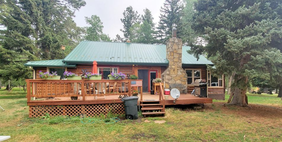 large deck, with a beautiful stone chimney