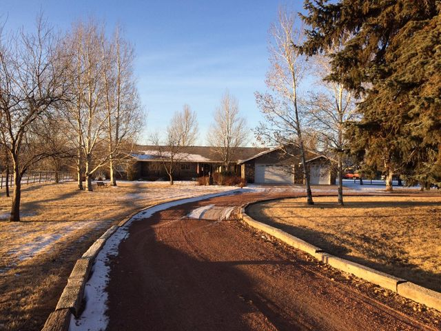 Hard to find comp. 7.7 acres in city limits of Ranchester on city water and sewer. Yard is almost an acre with automatic sprinkler system. Pasture is set up with automatic  waterers and 1 heated. 5 mile creek meanders thru almost 1/2 of this acreage . Set and relax by the creek or move over to the large fire pit area.  Great barn with tack room,inside hay storage and 2 large overhangs one for horses one for boat or RV.You will be at home as soon as you step out of your vehicle.