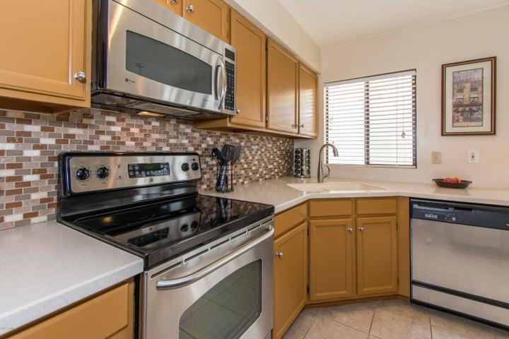 2014 kitchen upgrades: Corian counters and sink, faucet, garbage disposal, tile flooring, backsplash