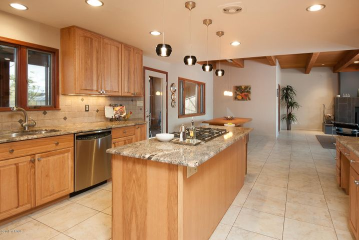 Slab granite counters, tile backsplash, Grohe faucet, reverse osmosis system, recessed lighting.