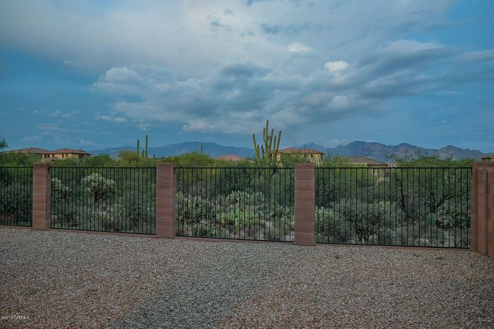 Privacy! Backs to natural desert area with a single story home on each side.