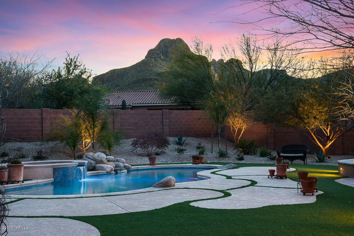 Amazing backyard with pool and spa, turf yard, timed lighting and irrigation.