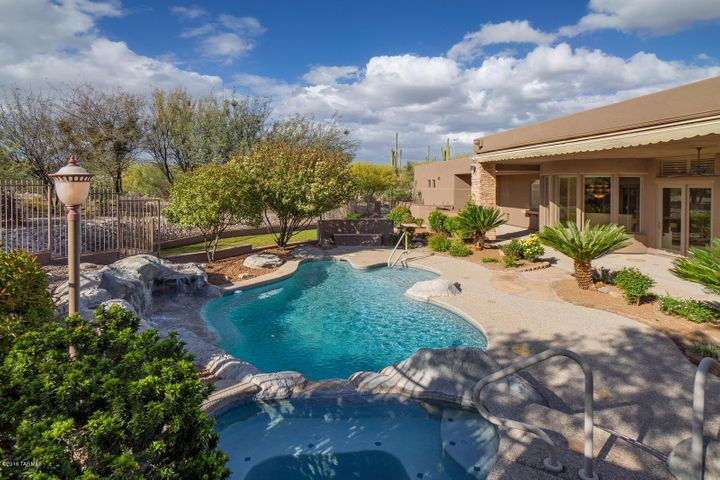 Elevated Custom Spa overlooks Pool and Garden