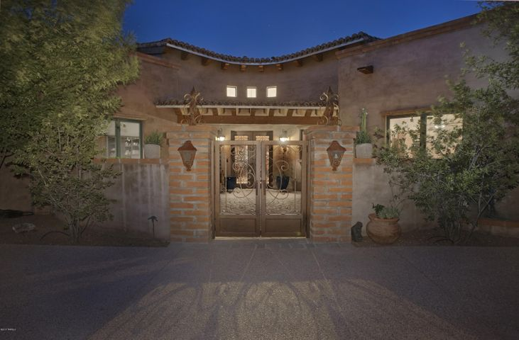 A special entrance with wonderful adobe pillars, wrought iron gate and charm!