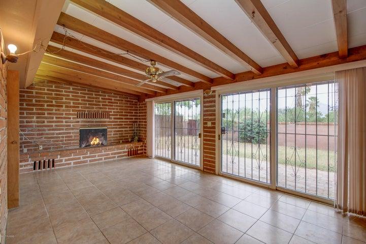 Wonderful gathering room w/wood beamed ceiling, tile floor and wall of windows!