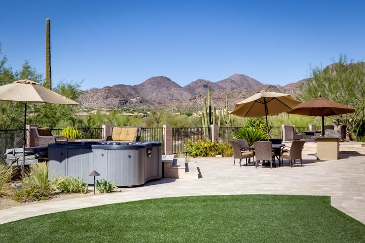 Gorgeous views, professionally designed landscaping, artificial grass and much more!