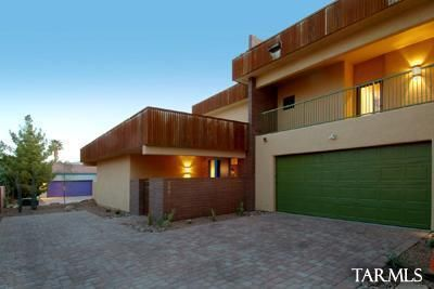Paver driveway, west side of 3 plex to 3221 entry courtyard &apron parking. Blue door 2 car garage not seen. Garage -Alley access. North mountain views plus east sunrise views from 2nd floor balconies. Rusted steel accents.