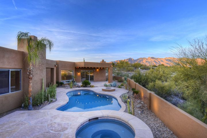 Views to the Catalina Mountains & Tucson City Lights abound from inside & outside this wonderful home.