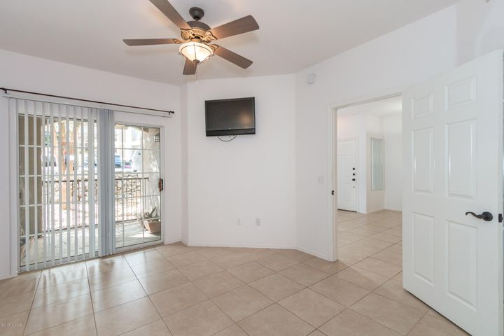 Spacious bedroom with ceramic tile throughout.