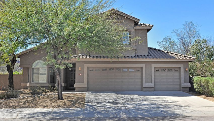 Gorgeous curb appeal, 3 car garage, covered front porch and mature trees