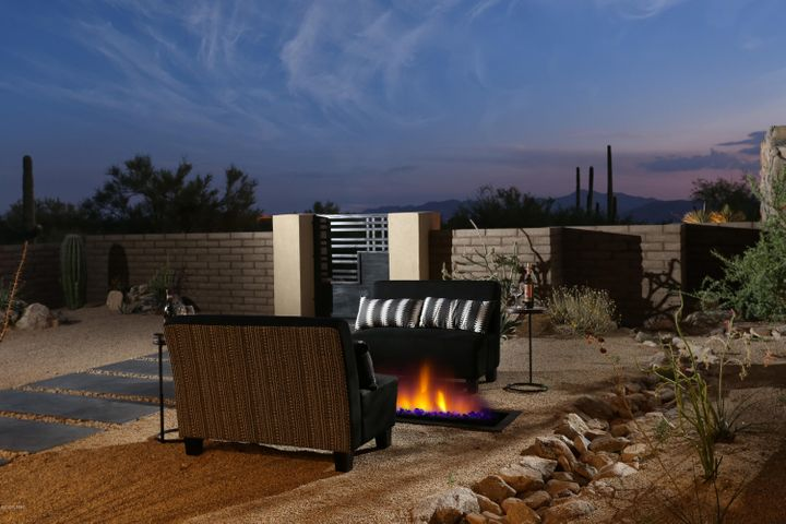 The front courtyard includes a large covered area, fire pit, and simply gorgeous views of the Tucson Mountains, including Wasson Peak & Sombrero.