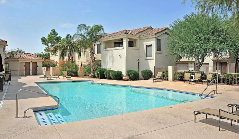 Large pool with spa directly across from unit