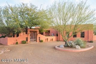 Circular driveway and gated courtyard welcomes guests