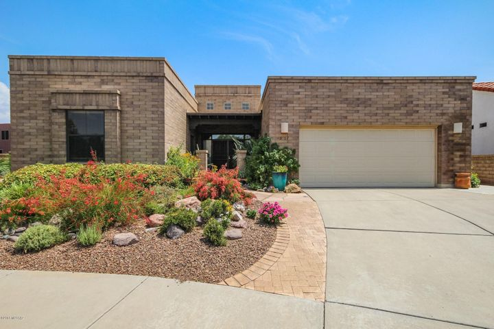 Great curb appeal with colorful flowering plants!