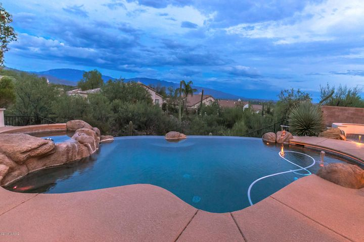 Resort like rear yard with negative edge Pebble Tec pool and soothing spa.