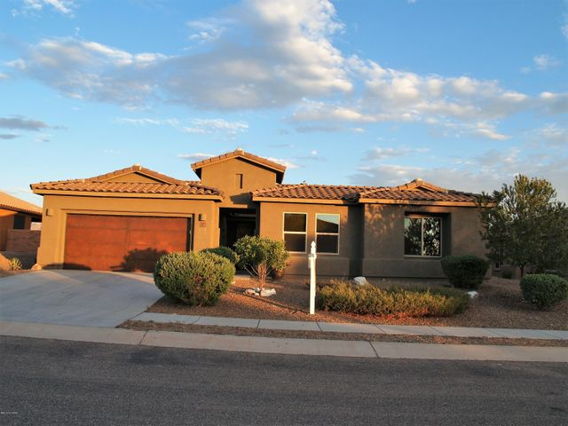 Front Home View featuring Rustic Garage Doors