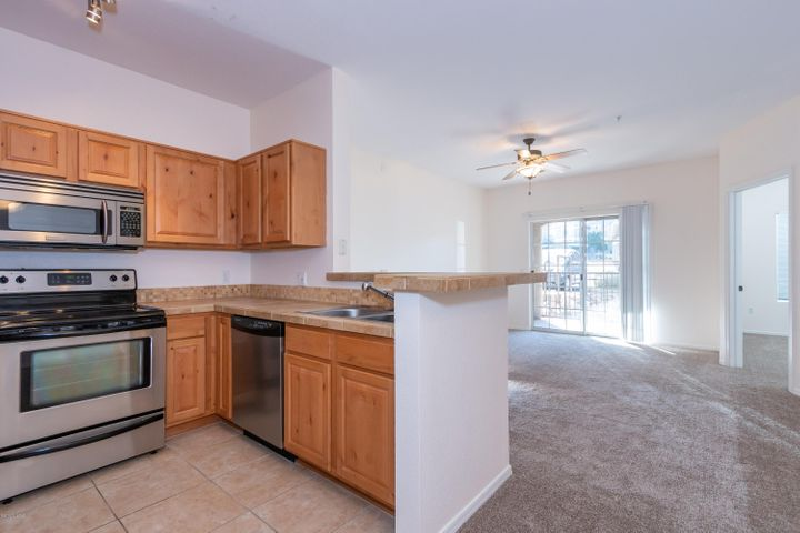 From the kitchen you are able to see living room, patio, second bedroom, hallway laundry closet, and dining room.
