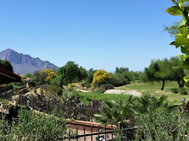 Mountain and golf course views await! And, backyard privacy.