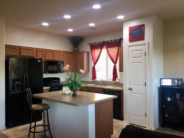 Brand new listing! Kitchen bar, pantry, gas stove, dishwasher, microwave, black appliances.