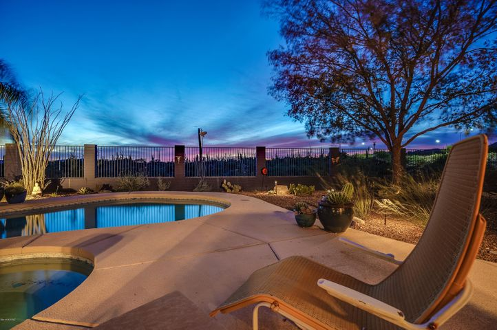 No house behind; gorgeous saguaro studded honeybee canyon is your backdrop
