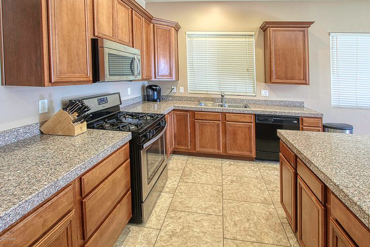 Kitchen w/Maple Cabinets and Granite Counter tops